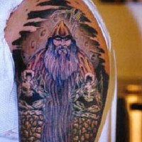 Viking shoulder tattoo with warrior and big moon