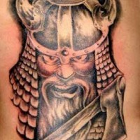 Angry viking warrior in horned helmet tattoo