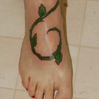 Realistic green vine tattoo on foot
