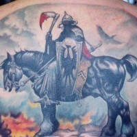 Warrior on horse with axe in blood back tattoo