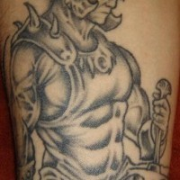 Serious warrior with skull helmet tattoo