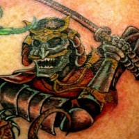 Colored green monster warrior with sword tattoo