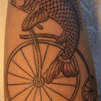 Tattoo with fish on the old bicycle