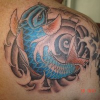 Blue fish in water swirl tattoo