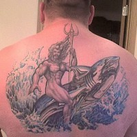 Man with trident on the whale in waves back tattoo
