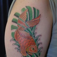 Goldfish in green waves tattoo on shoulder