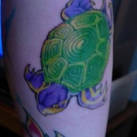 Water animal tattoo with colorful turtle