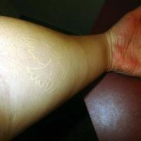 White ink tattoo with bird