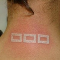 White ink tattoo with quadrates on back neck