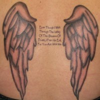 Angel wings and script tattoo