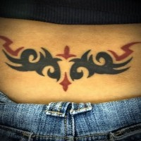 Women lower back tattoo, black and red styled