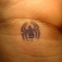 Little spider inner wrist tattoo