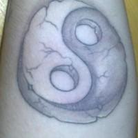 Volumetric yin yang tattoo in crushed stone style