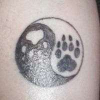 Yin yang tattoo with animal paws
