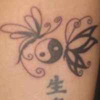 Yin yang tattoo with butterflies and characters