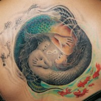 Yin and yang tattoo with mermaids