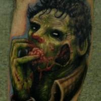 Gran tatuaje en verde el zombi comiendo