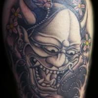 Tattoo demon on arm