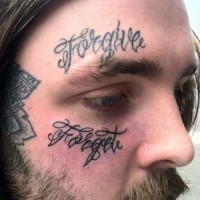 Tattoo forgive on face for men