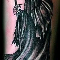 Terrible death tattoo by Robert Kidd