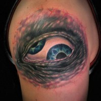 Terrible eye with two pupils tattoo on half sleeve