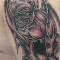 Terrible gargoyle with green eyes tattoo