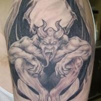 Terrible gragoyle tattoo on shoulder