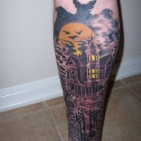 Terrifying big mystical old house tattoo on leg with bats and moon