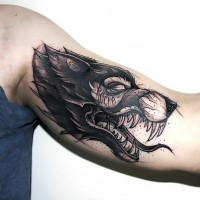 Terrifying black ink biceps tattoo of demonic wolf with lettering