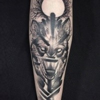 Terrifying black ink sleeve tattoo of demonic wolf and moon