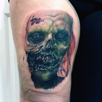 Terrifying detailed and colored arm tattoo on zombie face