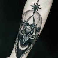 Terrifying looking black ink forearm tattoo of demonic face by Michele Zingales