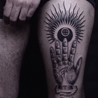 Terrifying looking black ink thigh tattoo of mysterious hand with symbols and sun