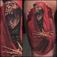 Terrifying looking colored tattoo of evil Grimm reaper