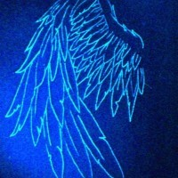 The wings on shoulder black light tattoo