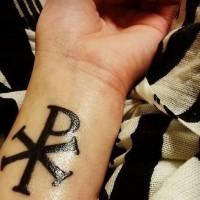 Thick dark black special symbol Christ monogram Chi Rho wrist religious tattoo