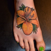 Tiger lily tattoo on ladies feet