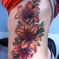Tiger lily tattoo on ribs