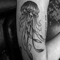 Tine old school black and white jellyfish tattoo on arm