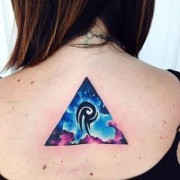 Tiny colored upper back tattoo of triangle with space