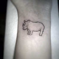 Tiny homemade wrist tattoo of tiny rhino