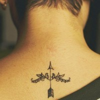 Tiny little black ink upper back arrow tattoo