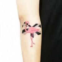 Tiny pink colored beautiful flamingo tattoo on forearm