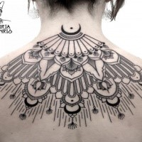 Traditional black ink back tattoo of impressive ornaments
