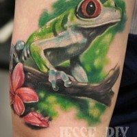 Tree frog with pink flower tattoo