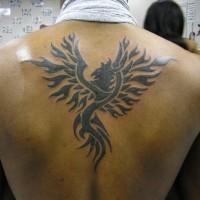 Tribal phoenix tattoo on back