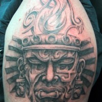Tribal style black ink shoulder tattoo of antic fire pit