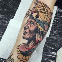 Tribal style colored forearm tattoo of old Indian