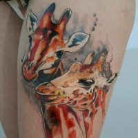 Two ink painted giraffe tattoo