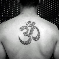 Typical black ink back tattoo of Hinduism symbol